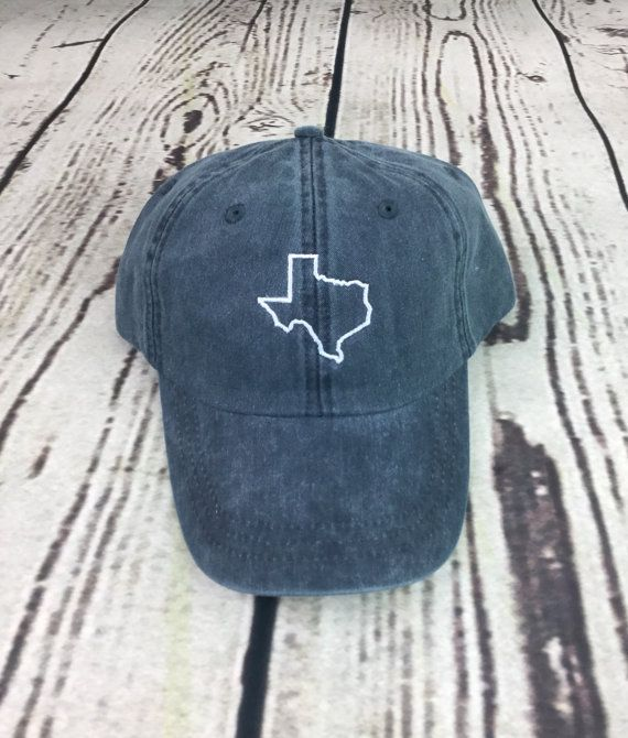 **All states available. If you dont see the state youre looking for, please just send a message and we can get it made for you!**  Pictured is a state of Texas embroidered pigment dyed hat. All of the hats are pigment dyed and have a brown leather strap in the back, EXCEPT for the gray hat. The gray hat is not pigment dyed and has a fabric strap and slide adjuster on the back, see picture. If you have any questions about the difference, please feel free to ask! When placing your order…