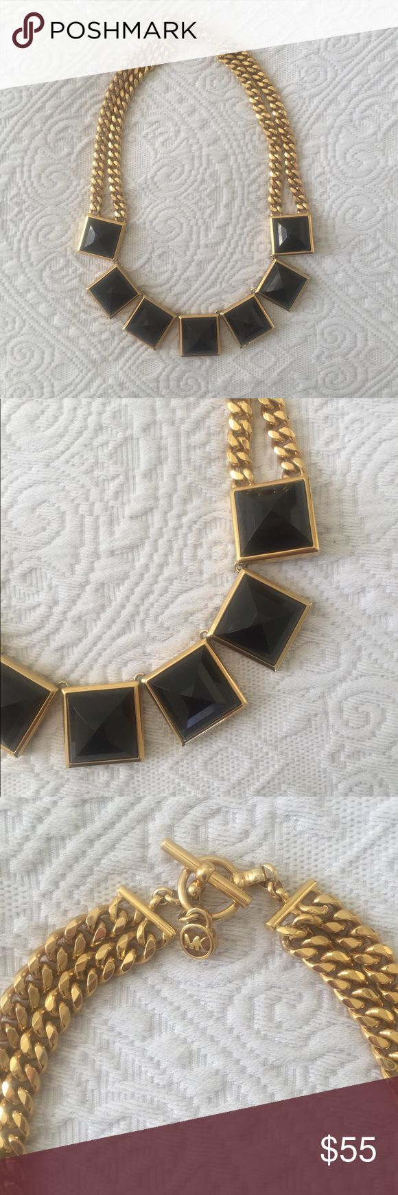 Michael Kors black and gold statement necklace Michael Kors necklace- 7 black squares outlined in gold with 4 gold rope chains leading to a toggle. Very cute!! Hardly worn. Comes with a brown Michael Kors jewelry bag! Authentic Michael Kors. Michael Kors Jewelry Necklaces
