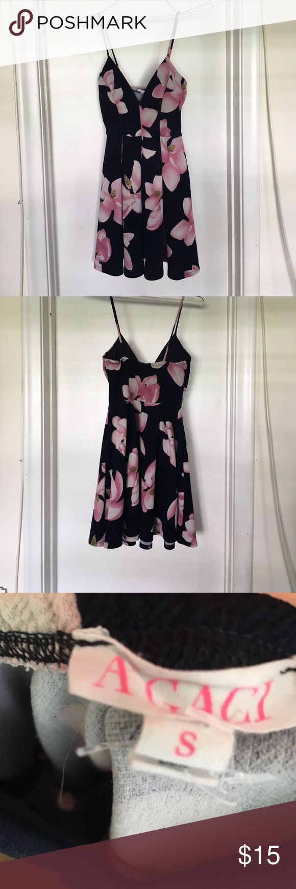 """VERY PRETTY A'GACI NAVY AND PINK FLORAL DRESS. Reposhing this A'GACI very pretty navy and pink floral dress. Loved the print! So sad! Tag says Size Small however it's a small for I'd say a young teen or a super tiny person. Measures approximately 10"""" across and 16"""" from line a little above the waist.. 96% Polyester, 4% Spandex. Great condition. Dresses Mini"""