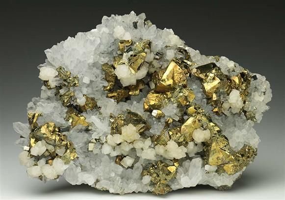 Chalcopyrite, Pyrite and Calcite on Quartz from Romania