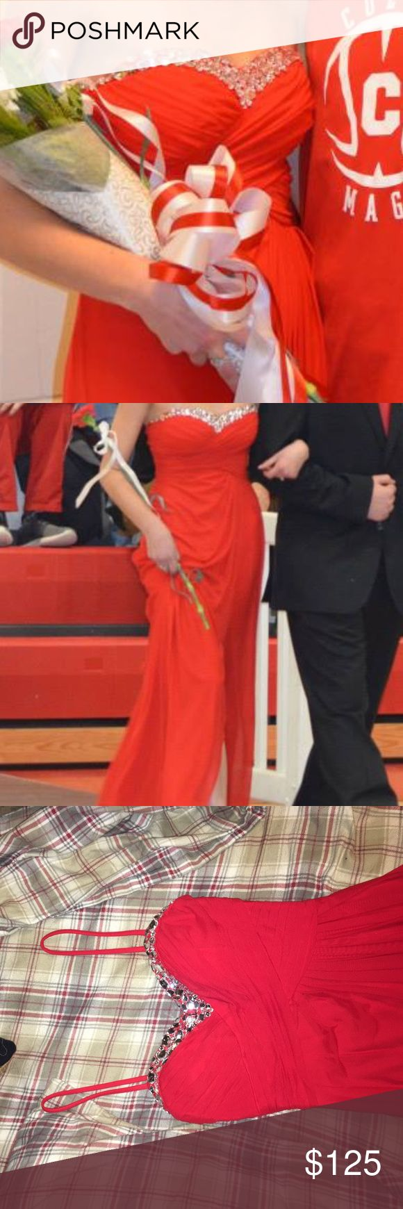 Prom Dress Simple but elegant red prom dress. Tag says it's a 1/2 but probably fits more like a 0. Has slit on the left side, and partially open back. Worn once, but only for a couple hours. No gems are falling off and it's in perfect condition Hailey Logan Dresses Prom