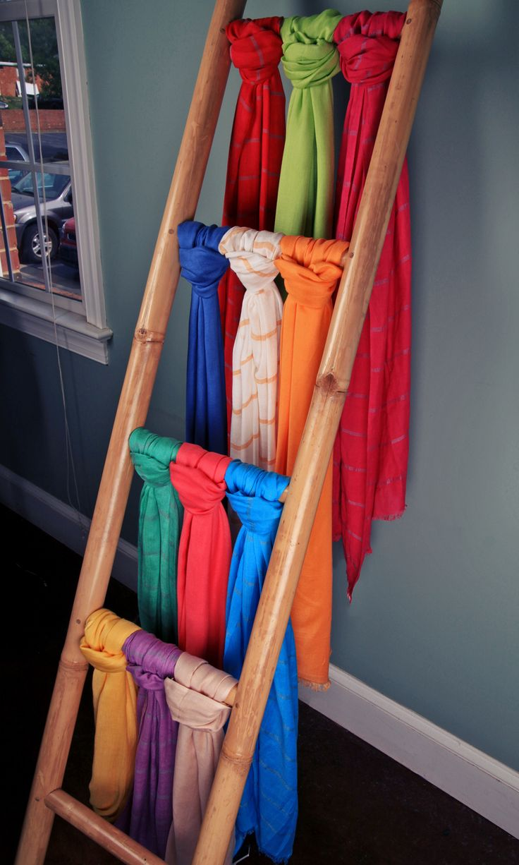 A simple bamboo ladder can give a novel feel to a scarf display. Rest the ladder away from the wall to provide an interesting look from every angle.