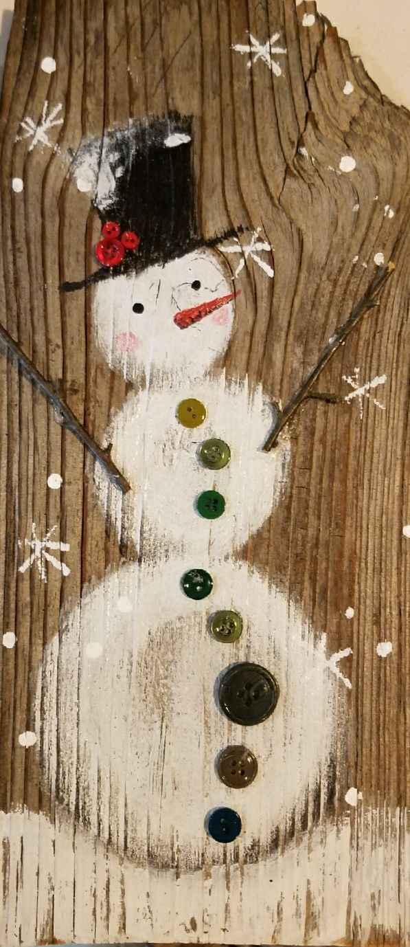 Painted Snowman on barnwood.  Foundandforagedstudio.com