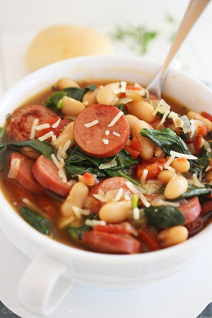 Smoked Sausage, Spinach and White Bean Soup – Hearty, healthy and full of flavor, this soup is our new favorite weeknight meal. You won't believe how simple it is, too! | thecomfortofcooking.com
