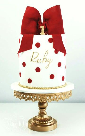 WHITE CAKE WITH RED POLKA DOTS AND FONDANT BOW