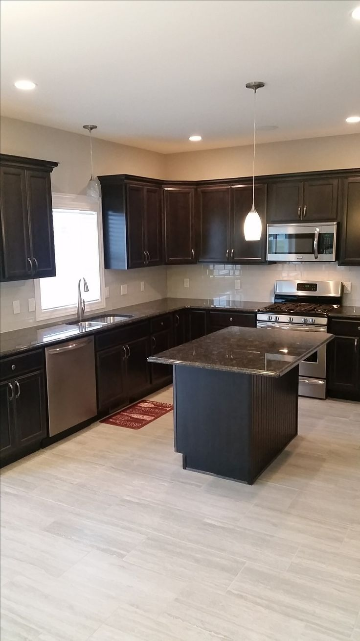 Stainless Steel Utilities Dark Wood Cabinets With Crown Mold Island With Over Hang Standard Kitche Trendy Kitchen Tile Wood Floor Kitchen Kitchen Table Wood