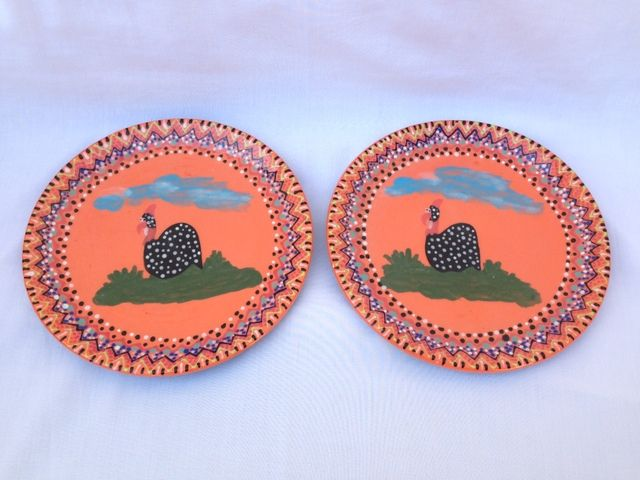 Hand painted ceramic plates x 2