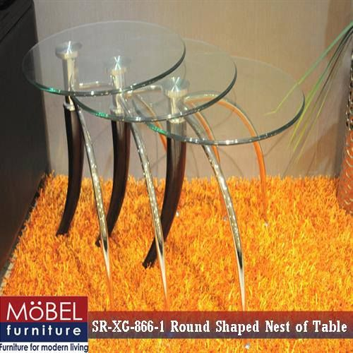 Round shaped nest of table that is a perfect match to modern home decor. With its elegant design and contemporary style, this table can add to the glamour of your home.