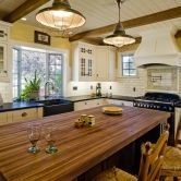 An eat-in-kitchen design with country styled cabinets from Dura Supreme #Cabinetry has traditional #farmhouse elements including a wood countertop, subway-tiles and large ceiling beams. #Kitchen design by designer Linda Williams of Hahka Kitchens, #California. – Find more ideas like this at DuraSupreme.com  #DuraSupreme #interior #interiors #kitchens #remodeling #cabinets #remodel #durasupremecabinetry #cottage #cottagektichen #cottagekitchens #country #farmhousekitchen