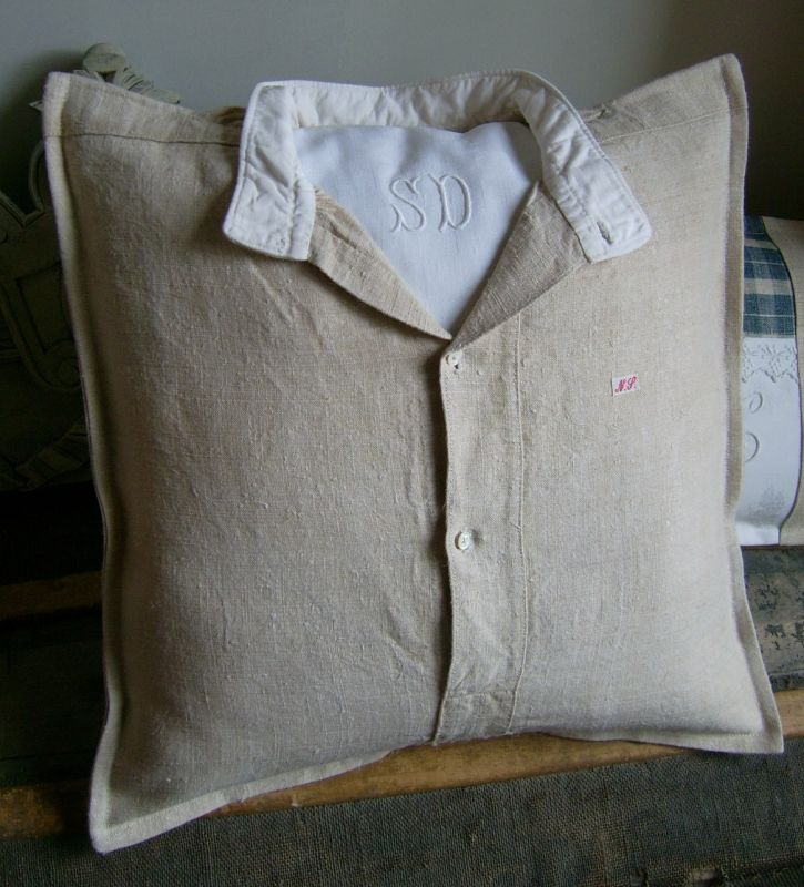 Cool idea! A pillow fabricated to look like a button down shirt.  Notice the monogram on the inside!