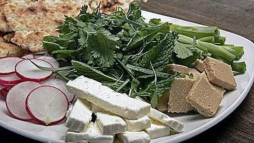 The traditional herb platter served in Persian restaurants combines mint, sweet tarragon, pepper cress and leek-chive with radishes, feta cheese and halvah. We could use fruitcake for halvah. Love the radish slices.