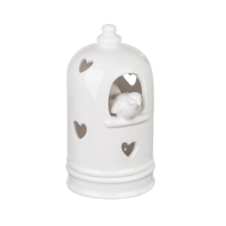 De theelichthouder is gemaakt van wit porselein en heeft de vorm van een vogelkooitje. In het koepeltje zitten hartvormige gaatjes waardoor het licht van het waxinelichtje naar buiten kan stralen. Door het deurtje komt het vogeltje naar buiten wippen, wat de theelichthouder een speels effect geeft.  De waxinelichthouder bestaat uit twee delen. Een onderkant waarop het waxinelichtje geplaatst kan worden, en een bovenste koepelvormig gedeelte dat erop geplaatst kan worden. Hierdoor is het…