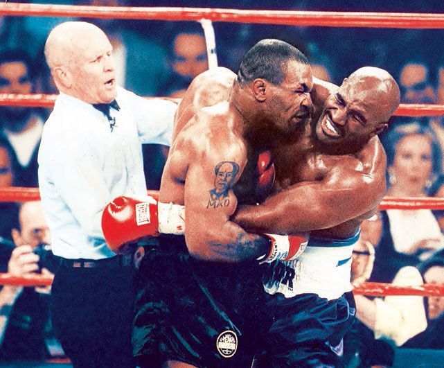 Fifteen years ago today, Mike Tyson famously famously took a chunk of Evander Holyfield's ear during their fight in Las Vegas. Holyfield was awarded the winner after Tyson was disqualified for the biting incident. (V.J. Lovero/SI)  GALLERY: Biting in Sports| Rare Photos of Mike TysonSI VAULT: Tyson drags his sport to new depths (7.7.97) #EasyPin