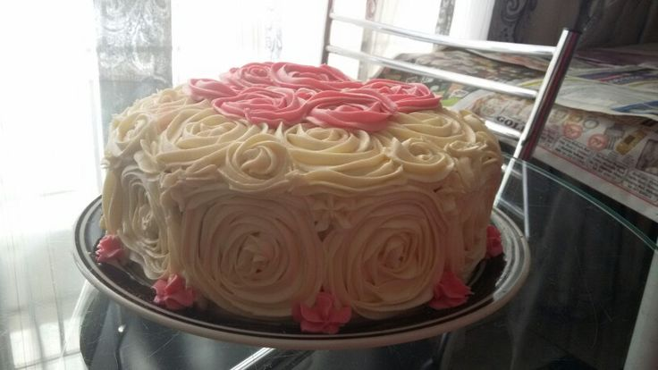 Cream cheese icing, rose piping
