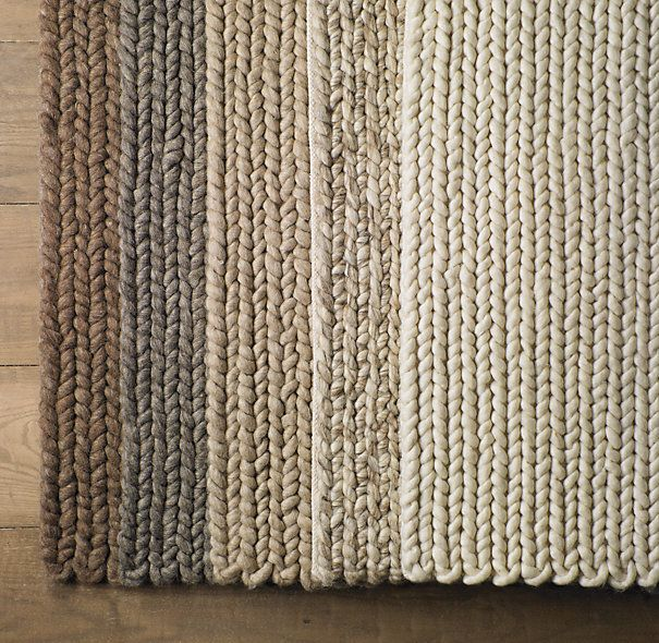 Shown (left to right) in mocha, grey, oatmeal, marled and cream.	  CHUNKY BRAIDED WOOL RUG