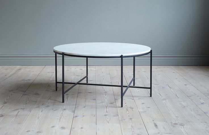 Round sofa table in black steel with a white marble top.