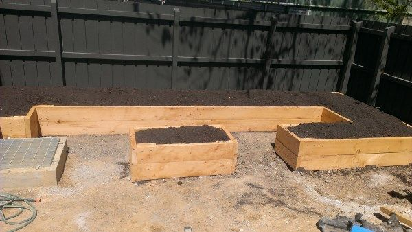 Irregular shaped raised veggie beds designed and built by Yummy Gardens Melbourne