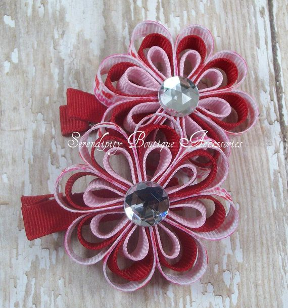 Been looking for info on making these-Ribbons looped in a quilling style.