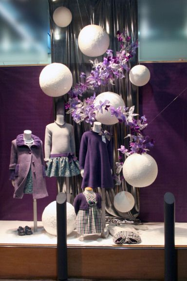Pili Carrera Boutique window display in Spain