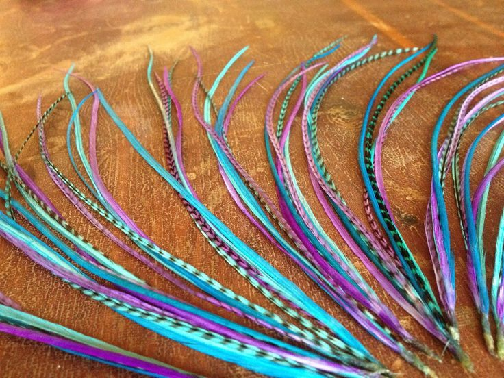 Feather Hair Extension - Jawbreaker bundle long colorful grizzly hair Feather extensions bonded hair feathers, crimp beads, and threader. $10.50, via Etsy.