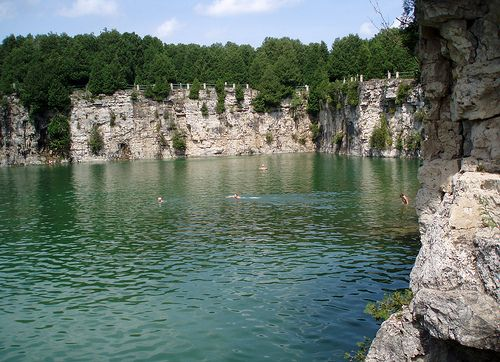 Grand River Conservation Authority. The 2-acre former limestone quarry is now a very popular swimming hole in Elora, Ontario, Canada
