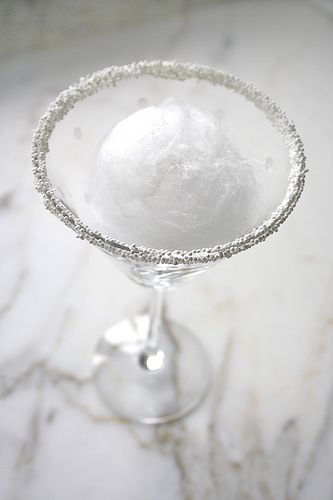 Snowball Martini.....Pinning this because I like the white non-perils on the rim!  Recipe calls for a ball of White Cotton Candy....don't think I will ever have any to make this drink!