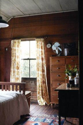 I love the golden hues of the timber lined walls, antique and recycled timber furniture and elephant stall curtains.