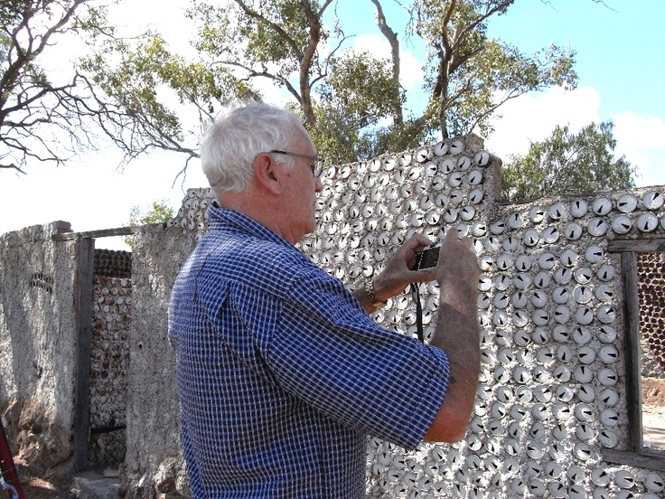 House made from tin cans near the first opal mine found at Lightning Ridge - Peter taking a shot