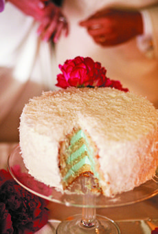 Brides: Alexis & Mukang in Coconut Grove, FL : Wedding Cakes Gallery    ALEXIS & MUKANG IN COCONUT GROVE, FL  Ali and Mook sliced into the coconut wedding cake, revealing blue cream filling.    read the full story ››  DETAILS    Cake Shape: Round Or Oval  Decorations: Flowers  Real Weddings: Real Weddings