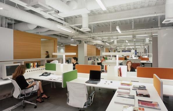 open plan office coordinated with orange and green panels