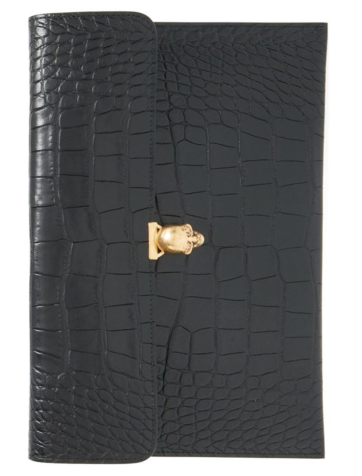 Statement-making, sleek and totally gorgeous—this calfskin Alexander McQueen envelope clutch is sure to add an extra 'oomph' to any stylish ensemble.