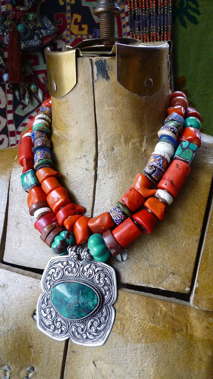 Necklace | Helena Nelson-Reed.  Silver and turquoise Indian pendant is combined with coral, vintage Venetian trade beads, bauxite, conch shells, inlaid yak bone beads, four sided turquoise mosaic beads from either Nepal or Tibet.