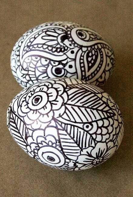 black marker drawings on white easter eggs