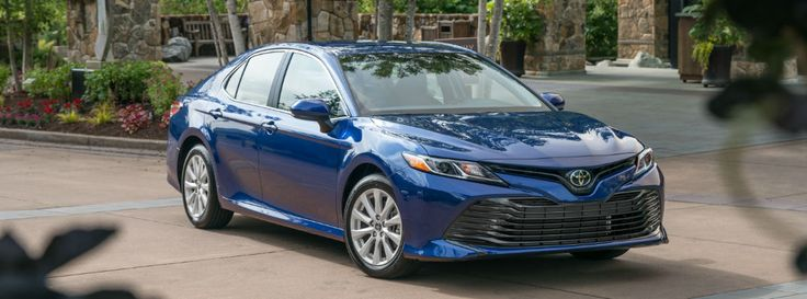 View of Blue 2018 Toyota Camry Front Exterior Through Trees