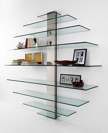 'Mondovisione' TV stand and/or library, fixed to the wall will decorate it, thanks to the design created by different sizes of the shelves.