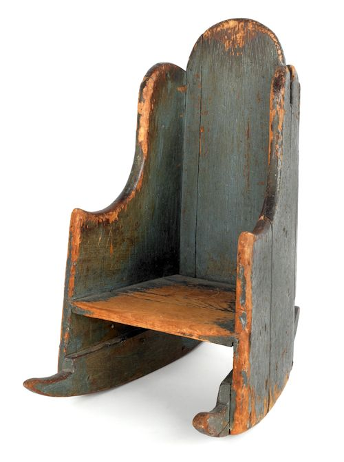 "New England painted pine child's settleback rocking chair, ca. 1760, with original blue painted surface and rose head nail construction, 24"" h., 12"" w. Provenance: Brian Windsor, Staten Island, New York."