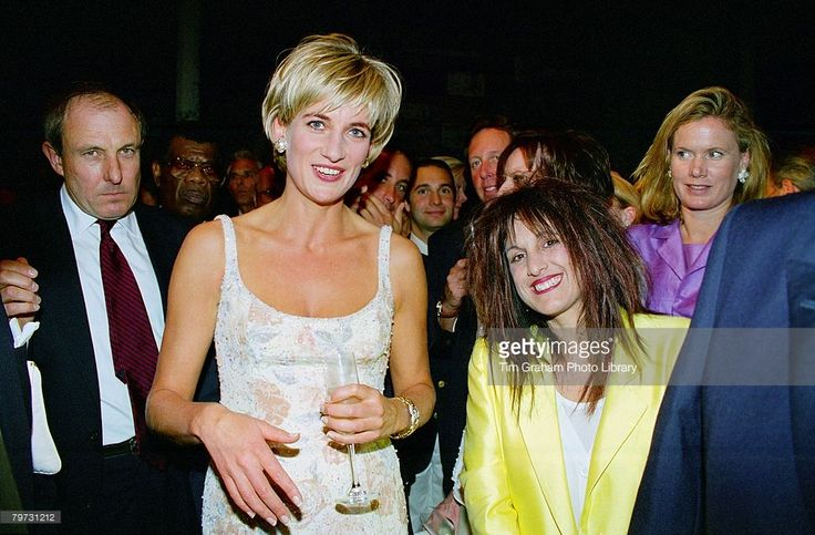 Diana, Princess of Wales with designer Elizabeth Emanuel at the pre-auction party at Christie's, New York, Her dress is by designer Catherine Walker, Diana's bodyguard, Dave Sharp, is on the left