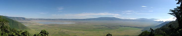 The Ngorongoro Crater is a large, unbroken, unflooded volcanic caldera. The crater, which formed when a giant volcano exploded and collapsed on itself some two to three million years ago, is 610 m (2,000 ft) deep and its floor covers 260 km2 (100 sq mi).[5] Estimates of the height of the original volcano range from fifteen to nineteen thousand feet (4500 to 5800 metres) high.