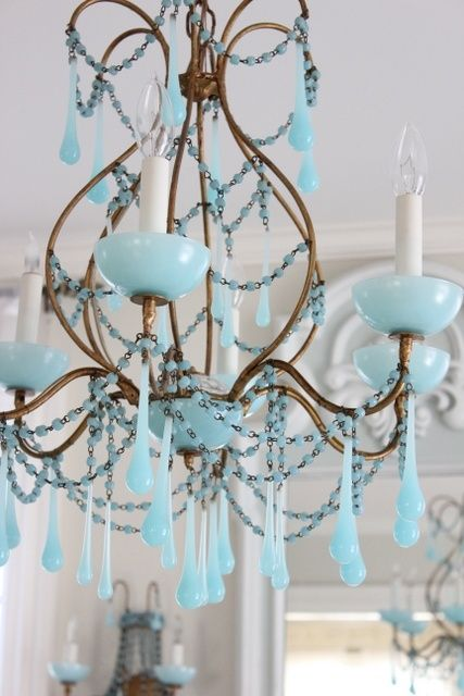 Pretty vintage blue chandelier. I'd probably have to put it up in my studio or office, because I doubt Brett would like it in the main house.
