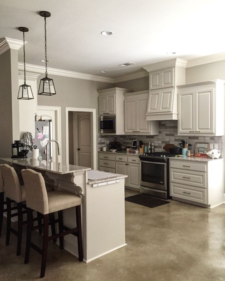 The wall color is Benjamin Moore Revere Pewter (HC-172); the cabinets are Benjamin Moore Edgecomb Gray (HC-173); the trim is Benjamin Moore White Dove (OC-17) | Travertine tile backsplash - I painted the darker tiles in Clark+Kensington Baby Elephant (3052) | 2cm Giallo Ornamental granite |