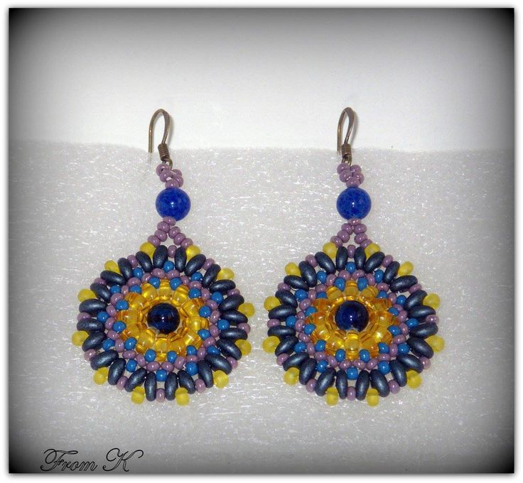 """Fairly popular circle design #earrings in Boho look. These earrings look wonderful with a casual dress or with jeans. The combination of colors will match a lot of different clothes for different acosions. Czech seed beads and special """"twin"""" beads are used here. (""""twin"""" bead is the latest trend in beaded jewelry). (for details see this items in my albums https://www.facebook.com/BeadsFromK/photos) Earrings - 20.00 Ron cod EGO 64 Available on order and in other colors."""