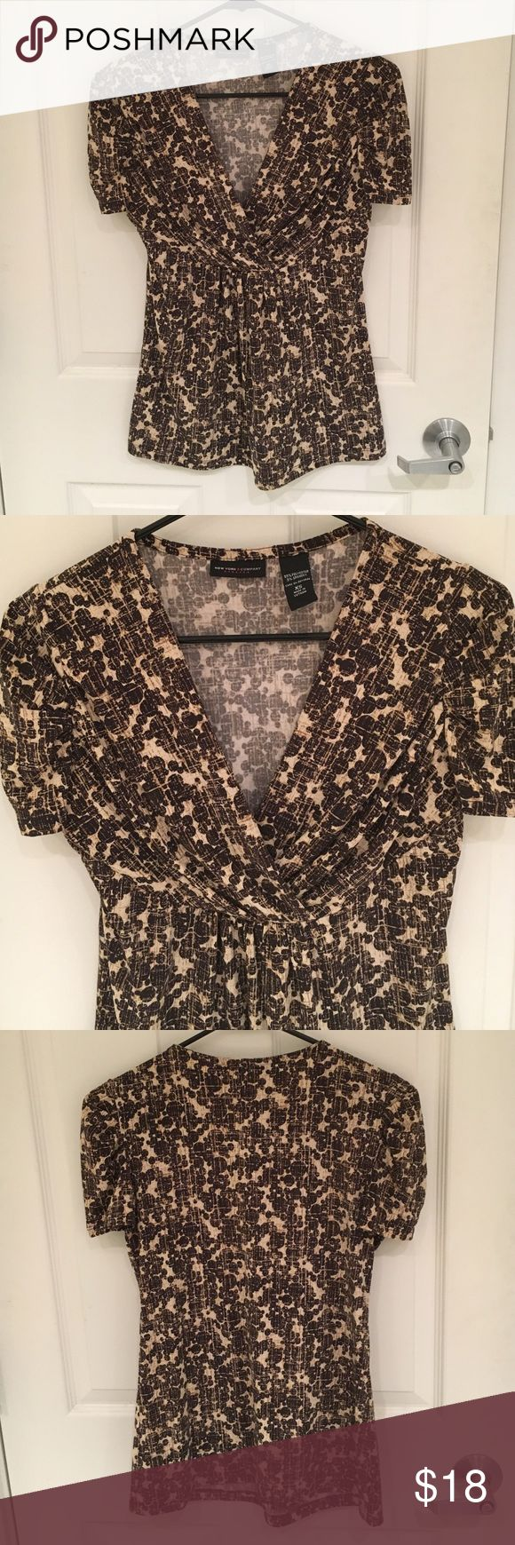 New York & Company Blouse Neutral colored, patterned V-neck shirt. Great for work and wearing with dress pants and heels. Short-sleeves. Gathers a little under the bust. Very flattering. New York & Company Tops Blouses