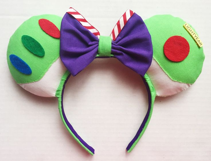 Buzz Lightyear Inspired Mouse Ears by TheseLittleBeauties on Etsy https://www.etsy.com/listing/253358850/buzz-lightyear-inspired-mouse-ears