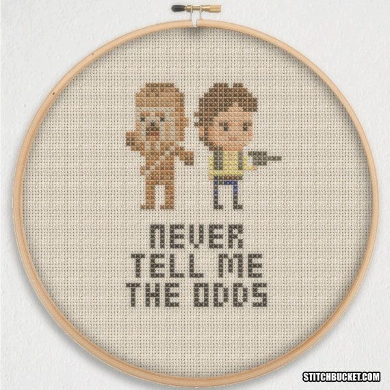 Never Tell Me The Odds! Stitch this famous Star Wars quote alongside Han Solo and Chewbacca in this awesomely simple cross stitch pattern.  This