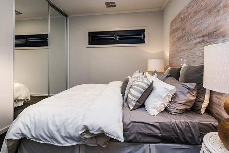 This charming bedroom features mirrored robe doors to add practicality and style. #weeksbuildinggroup #newhome #homedesign