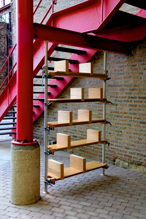 Modern bookshelves using autopoles and self stopping built in bookends