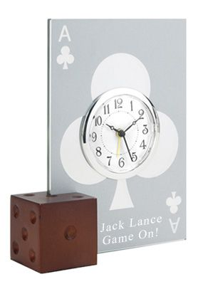 """Glass Poker Card Alarm Clock Size: 5""""L x 6""""W The Glass Poker Card Alarm Clock with Dice is a special gift for everyone. With an attractive poker heart design engraved on glass, the alarm clock is set into a majestic backboard coupled with a wooden dice base to complete the poker themed clock. This alarm clock serves the same purpose as a traditional alarm clock as poker and card players would love to have this in their collection. Are you presenting to a close friend or spouse? The Glass…"""