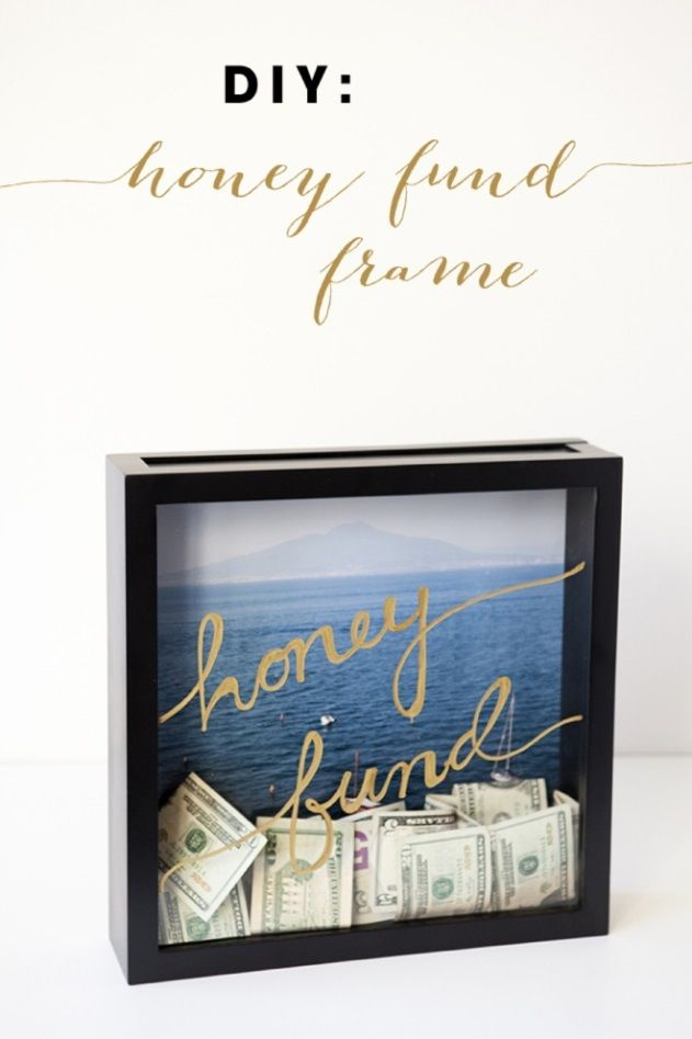 "Brides can skip the awkward money dance and create this cute ""honey fund"" frame instead. Wedding guests can donate cash to the newlyweds honeymoon fund during the entire reception! All you need is a shadow box, a pretty background picture and a metallic sharpie. #honeyfund"