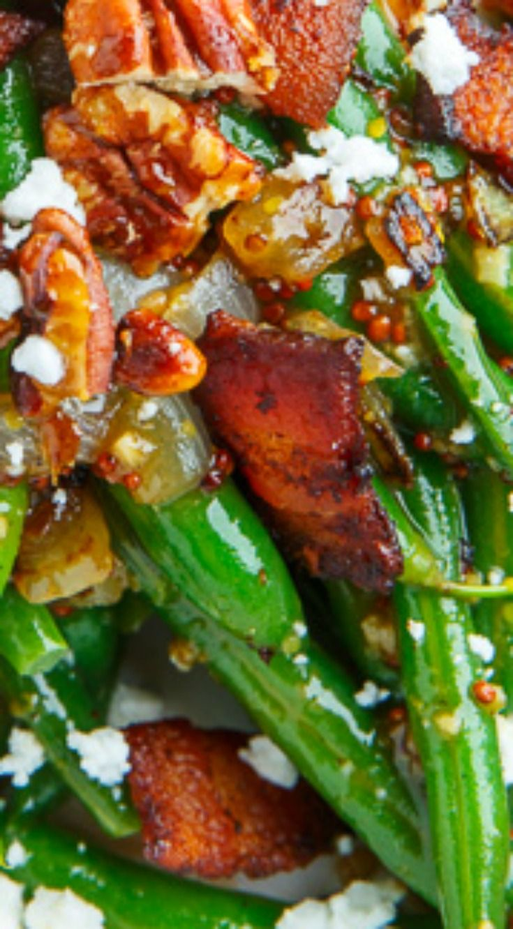 Maple Dijon Green Beans with Bacon, Candied Pecans and Goat Cheese ~ Green beans tossed in a tasty maple-dijon sauce and topped with crispy bacon, crunchy candied pecans and creamy goat cheese!