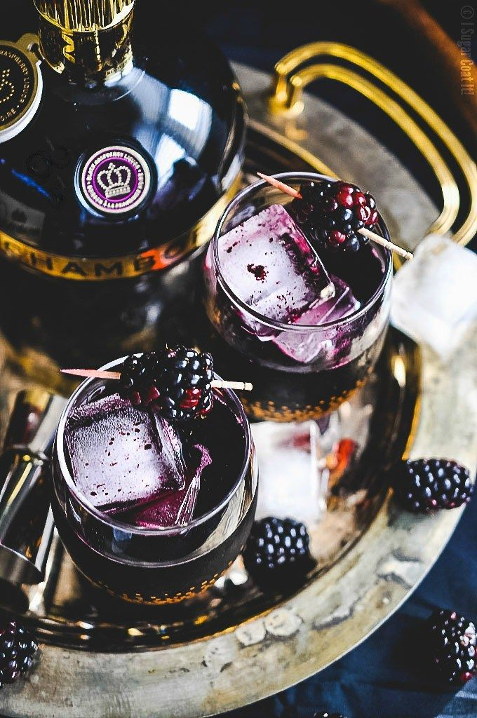 Blackberry Coulis Cocktail - A deliciously refreshing blend of blackberries, Chambord liqueur and dark rum and a little fizz ­ slightly sweet, a little tart and a whole lot of sexy.